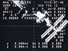 A video camera on the departing ISS<br /> Progress 49 cargo craft captured this<br /> view of the International Space Station.<br /> Credit: NASA TV<br /> <br /> <br />